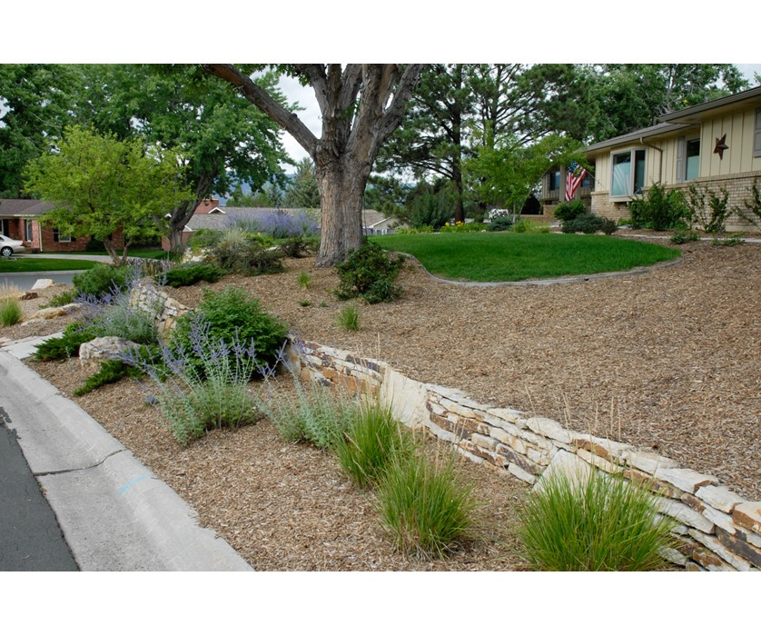 Colorado springs utilities xeriscaping corner lot cutback for Corner lot landscaping pictures